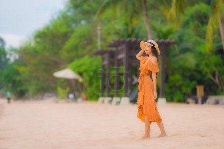Photo for Portrait beautiful young asian woman happy smile relax on the beach sea ocean at sunset time in holiday vacation - Royalty Free Image
