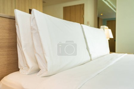 Photo for Pillow and blanket on bed with light lamp decoration interior of bedroom - Royalty Free Image