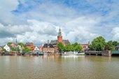 View from Leda river on City Hall and Old Weigh House in Leer, Germany