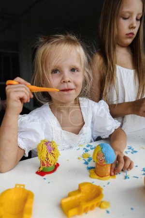 Photo for Little girls playing indoors - Royalty Free Image