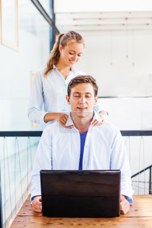 office worker getting massage from girl