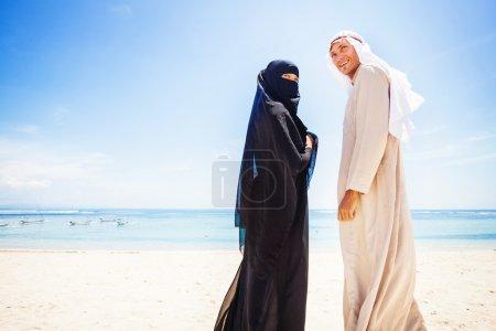 muslim couple on beach