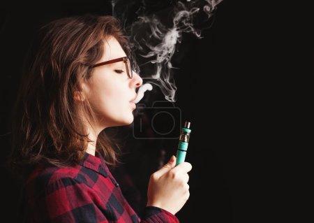 woman smoking electronic cigarette