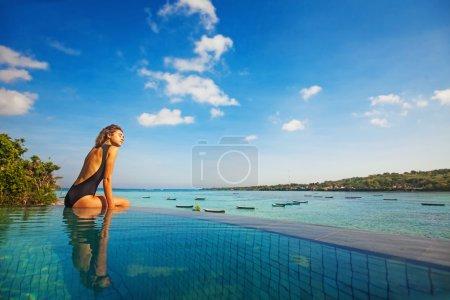 young girl at pool resort
