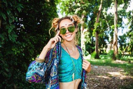 stylish hippie girl in forest