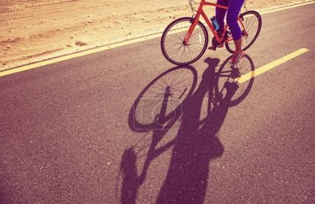 woman riding bike on a road