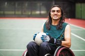 rugby player in a wheelchair practicing