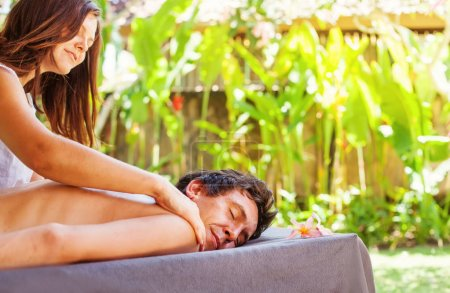 Caucasian man getting relaxing massage treatment