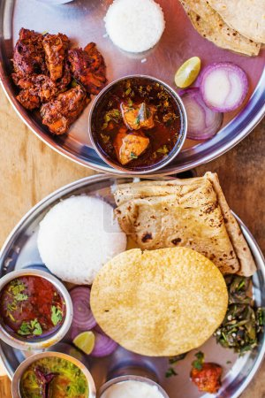 Top view of indian vegetarian and non-vegetarian food plates