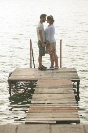 lovely couple near lake