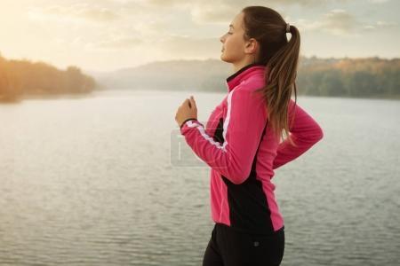 woman jogging at lake