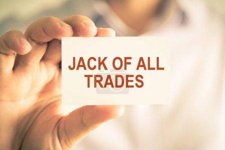 Photo pour Gros plan sur l'homme d'affaires détenant une carte avec texte Jack Of All Trades, image concept entreprise avec ton fond et vintage de flou artistique - image libre de droit
