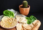 Homemade hummus with green salad