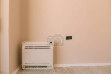 Square air conditioner in the apartment. On the floor, split sys