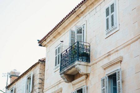 Forged balcony in an old house. Balkan architecture, Montenegro