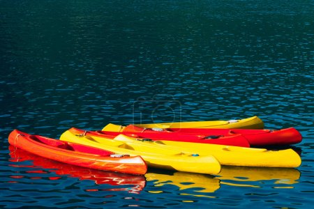 Kayaks moored in the water. Empty kayaks without people. In the