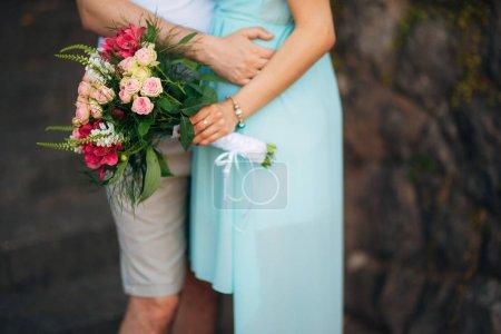 Wedding bouquet in hands of the bride. Wedding in ...