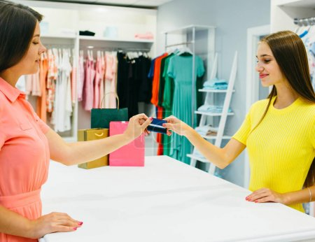 Woman in shop with credit card