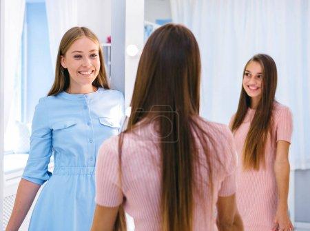 Girl looking at friend in wardrobe