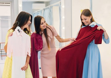 Girls choosing dresses in mall
