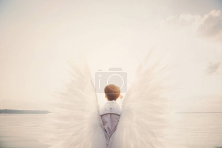 woman with white wings showing thumb up