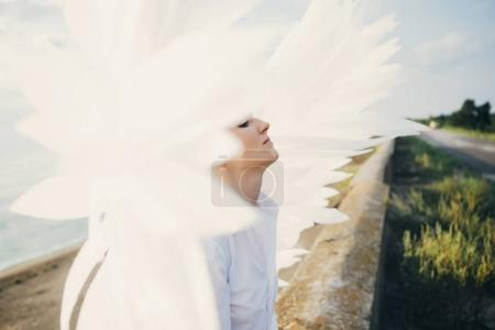 Young woman with white wings