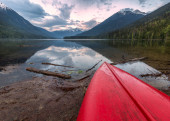 Canoe top on a shore with beautiful lake view