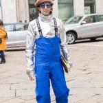 MILAN, ITALY - FEBRUARY 26: Fashionable man poses ...