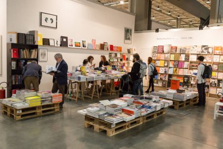 Photo for MILAN, ITALY - APRIL 1: People visit the bookstore at Miart, international exhibition of modern and contemporary art on APRIL 1, 2017 in Milan. - Royalty Free Image