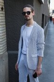 Fashionable man posing during Milan Men's Fashion Week