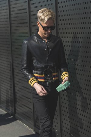 Photo for MILAN, ITALY - SEPTEMBER 20: Fashionable man poses outside Gucci fashion show building during Milan Women's Fashion Week on SEPTEMBER 20, 2017 in Milan. - Royalty Free Image