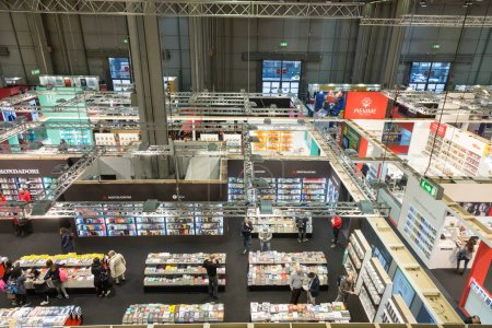 Photo for MILAN, ITALY - MARCH 8: Top view of people and booths at Tempo di Libri, the new Italian Publishing Fair on MARCH 8, 2018 in Milan. - Royalty Free Image