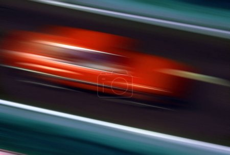Photo for Speed - Blur of a fast moving red car on a European motorway. - Royalty Free Image