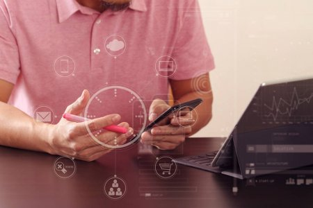 businessman in pink t-shirt working with smart phone and digitl