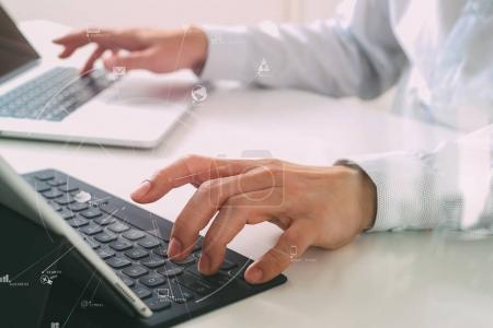 close up of businessman typing keyboard with laptop computer and