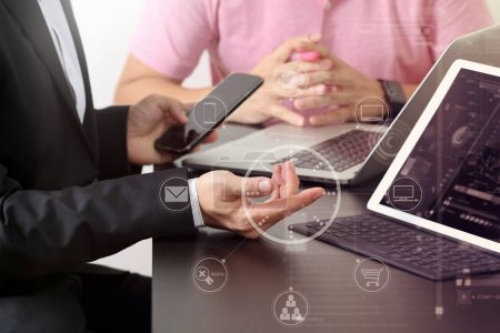 Photo for Co working team meeting concept,businessman using smart phone and digital tablet and laptop computer in modern office with virtual icon diagram - Royalty Free Image