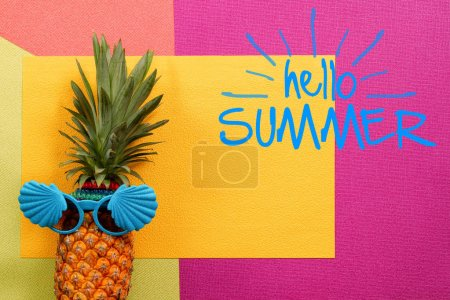 Photo for Summer and Holiday concept.Hipster Pineapple Fashion Accessories and Fruits on colorful and hello summer word background - Royalty Free Image