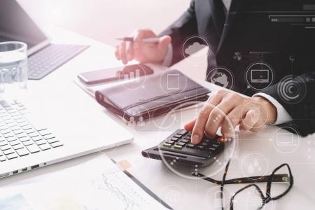 businessman hand working with finances about cost and calculater