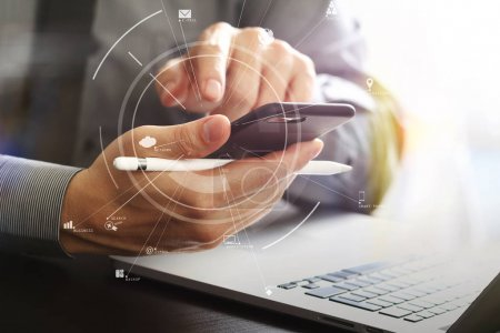 close up of businessman working with mobile phone and stylus pen