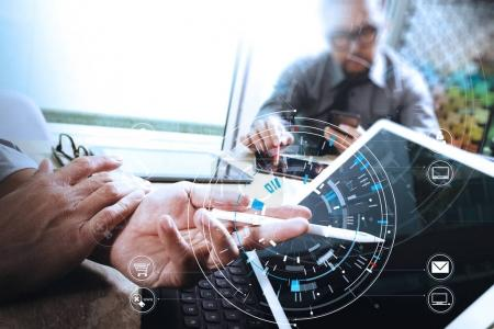 Businessmen working together on a document and using smart phone