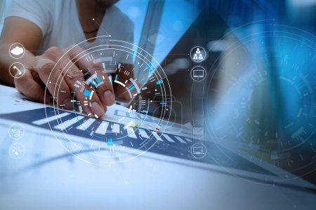 Photo for Businessman hand working with modern laptop computer in modern office with virtual icon diagram - Royalty Free Image