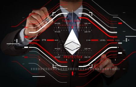 Businessman working with new modern computer and Ethereum crypto