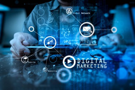 Photo for Digital marketing media (website ad, email, social network, SEO, video, mobile app) in virtual screen.businessman hand working with modern technology digital tablet computer and digital layer effect as business strategy concept. - Royalty Free Image