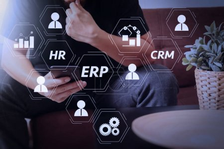 Photo for Architecture of ERP (Enterprise Resource Planning) system with connections between business intelligence (BI), production, CRM modules and HR diagram.designer man hand using smart phon for mobile payments online. - Royalty Free Image