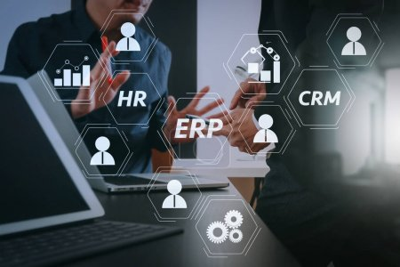 Photo for Architecture of ERP (Enterprise Resource Planning) system with connections between business intelligence (BI), production, CRM modules and HR diagram.co working team meeting concept,businessman using smart phone. - Royalty Free Image