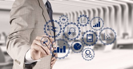 Business data analytics management with connected gear cogs with KPI financial charts and graph.businessman hand writing in the whiteboard or virtual screen