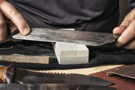 Photo for Whetstone in which hand-sharpened knife. - Royalty Free Image