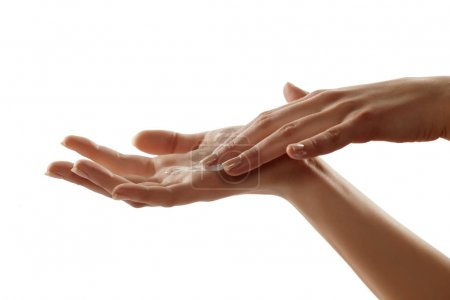 Photo for Close-up of female hands applying hand cream - Royalty Free Image