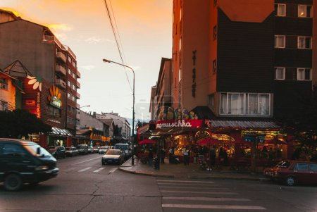 Photo for People walking by street of old city in evening - Royalty Free Image