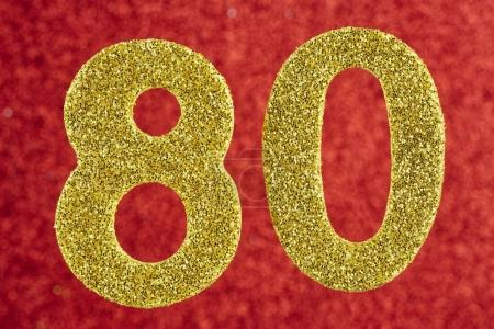Number eighty yellow color over a red background. Anniversary.